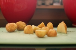 Chop the potatoes into 2cm dice.